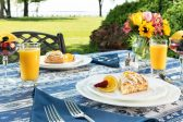Table set for breakfast with scones and fruit at our Eastern Shore bed and breakfast