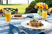 Outdoor table at our Chesapeake Bay B&B set for breakfast