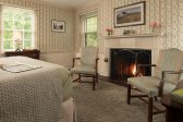 Hodges Room seating area and fireplace at our bed and breakfast on Chesapeake Bay