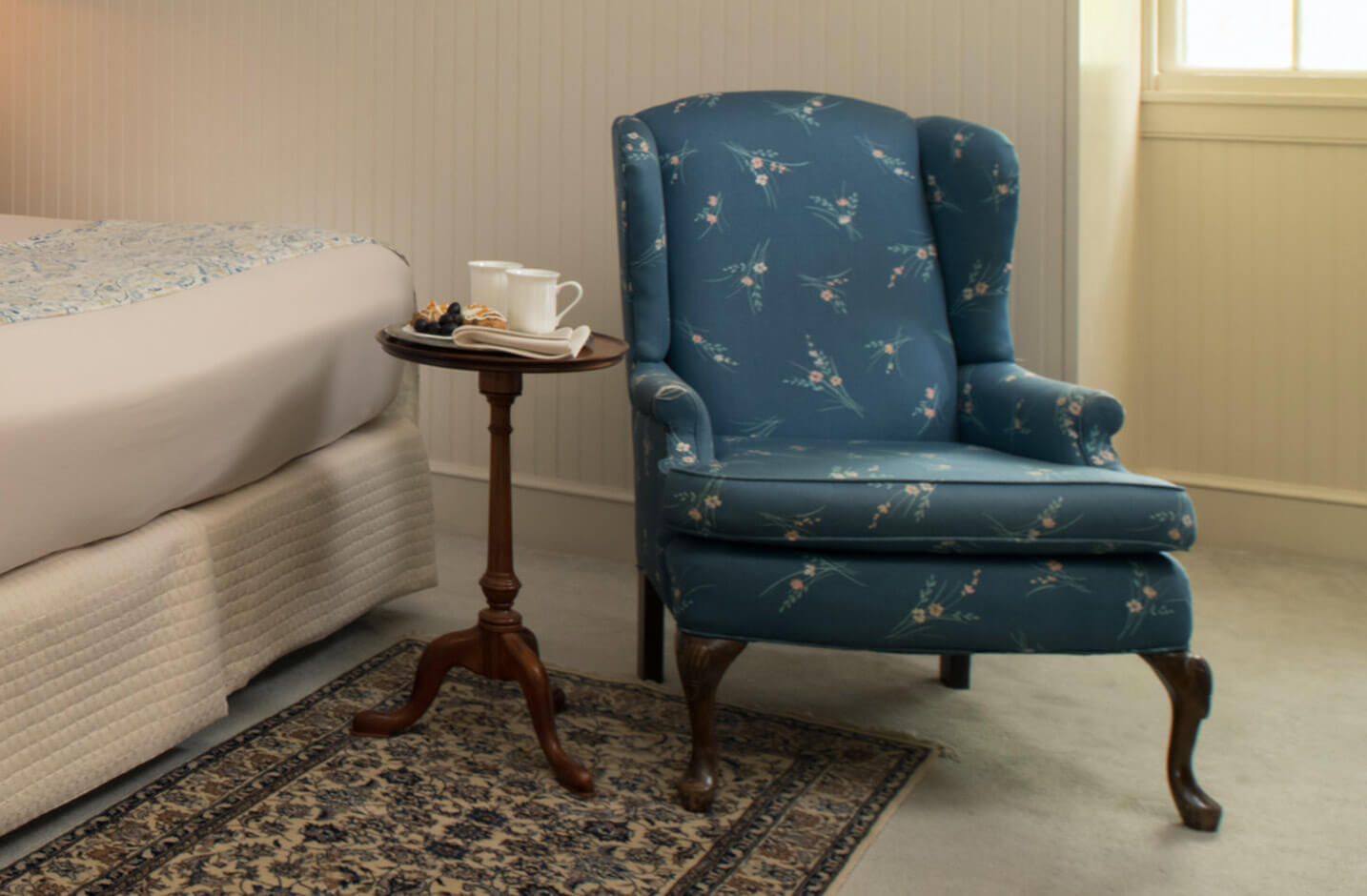 Ringgold Room reading chair with side table at our Eastern Shore B&B