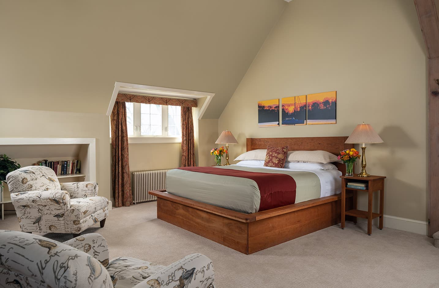 Russell Suite bed and seating area with fireplace at our Eastern Shore bed and breakfast