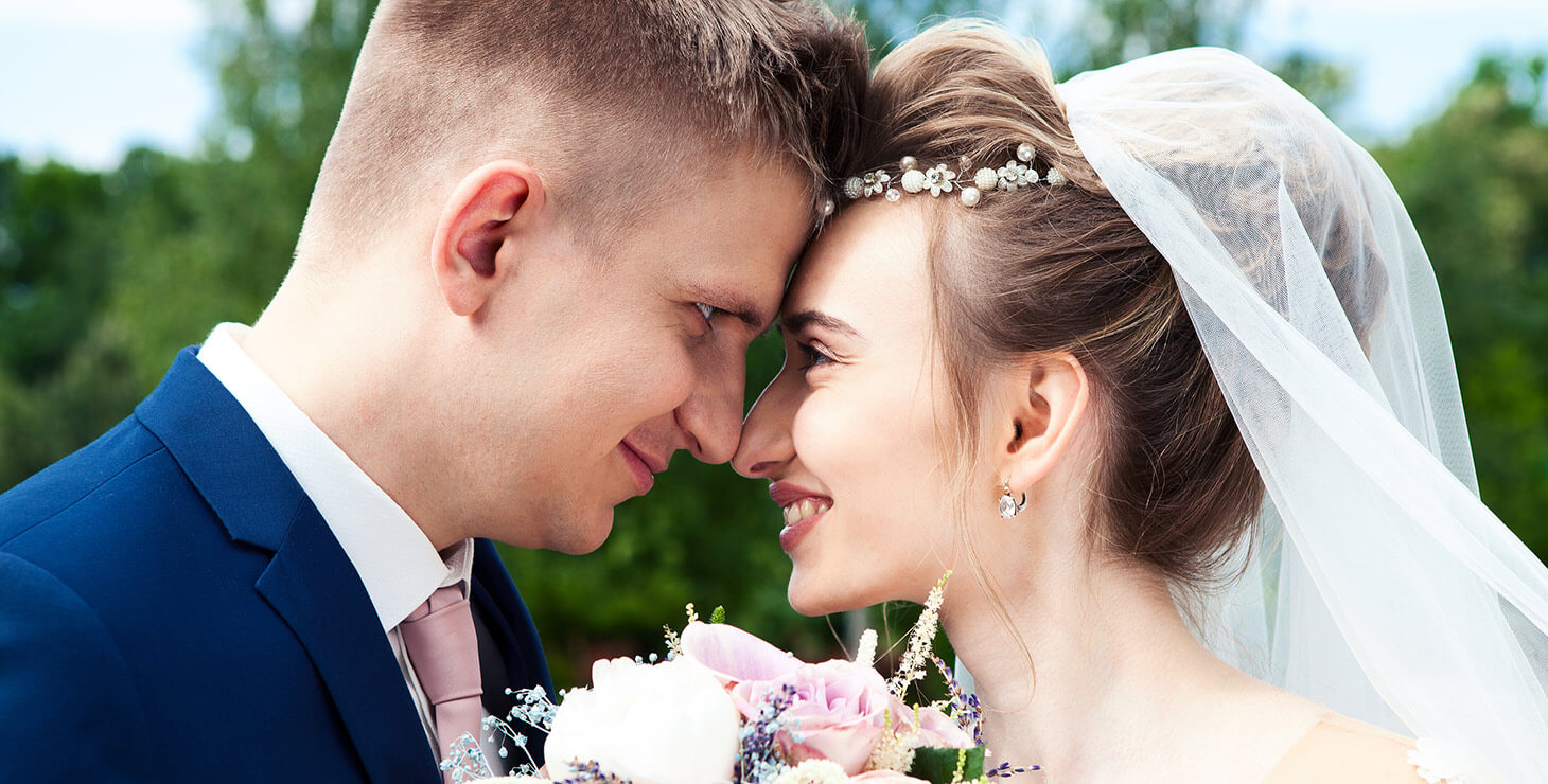 Bride and groom smiling at each other