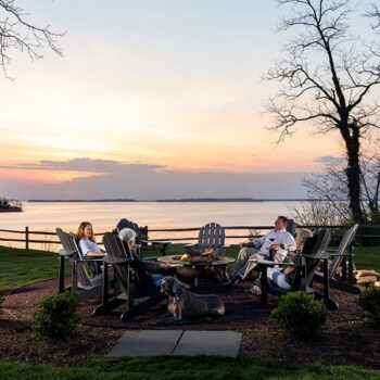 People gathered around the firepit at our Eastern Shore Maryland bed and breakfast