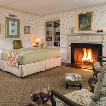 Marmaduke Room bed, seating area, and fireplace offers exceptional Chesapeake Bay lodging