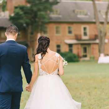 Bride and groom walking and holding hands at our wedding venue in Chestertown, MD