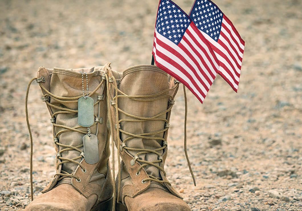 Military combat boots with flags