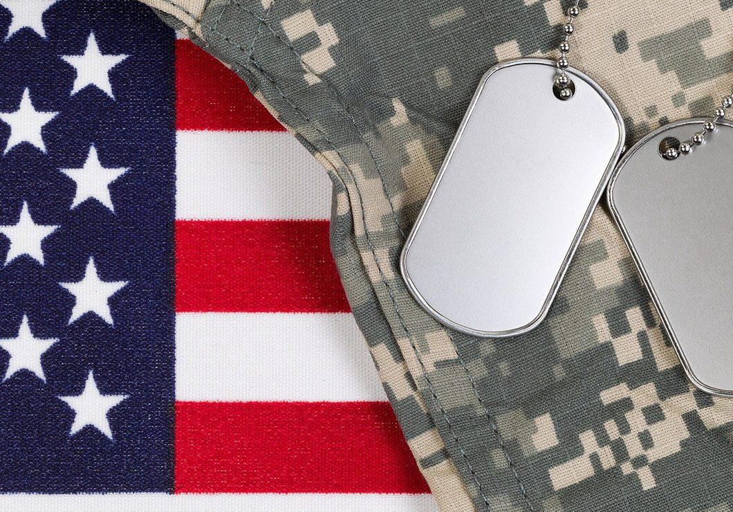 Military uniform with dog tags and flag