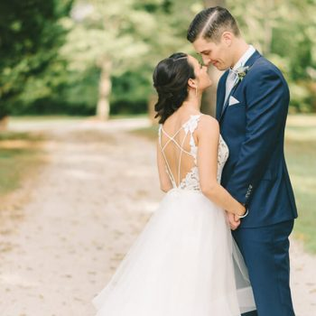 Bride and groom about to kiss on a dirt road at our Chestertown wedding venue