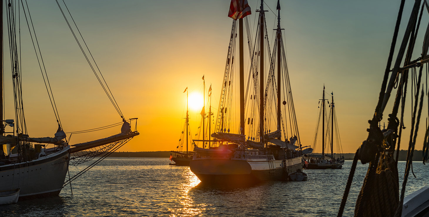 Wooden boats on Chesapeake Bay at sunset