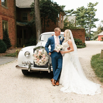 Bride and Groom in front of Classic Car