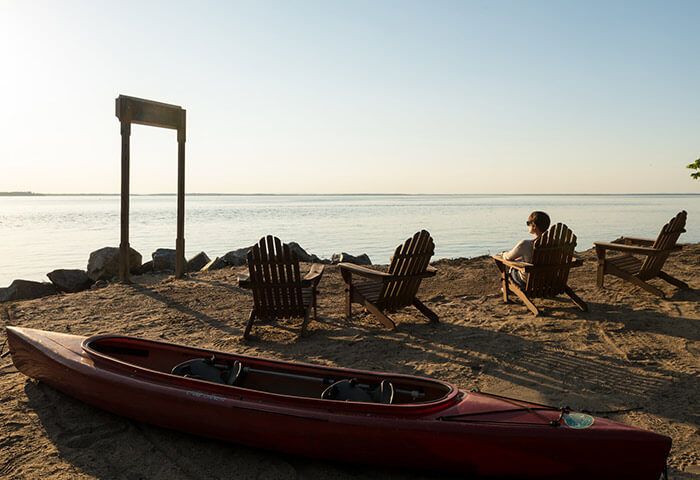 Kayak and chairs on the beach at our Cheaspeake Bay B&B