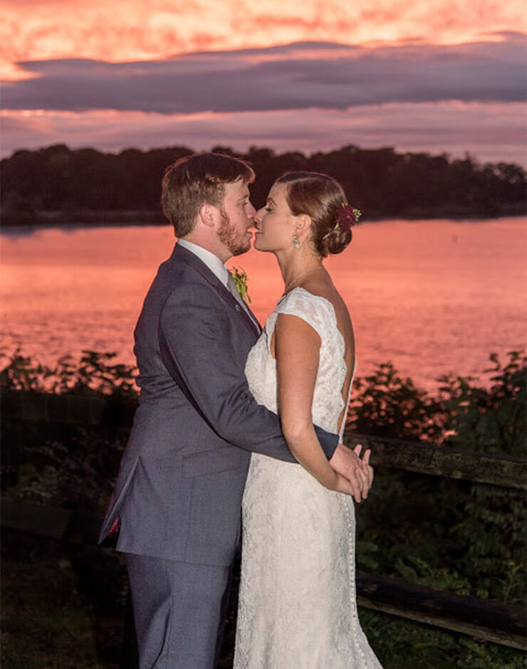 Wedding Kiss at Sunset in front of the water at our Cheaspeake Bay wedding venue