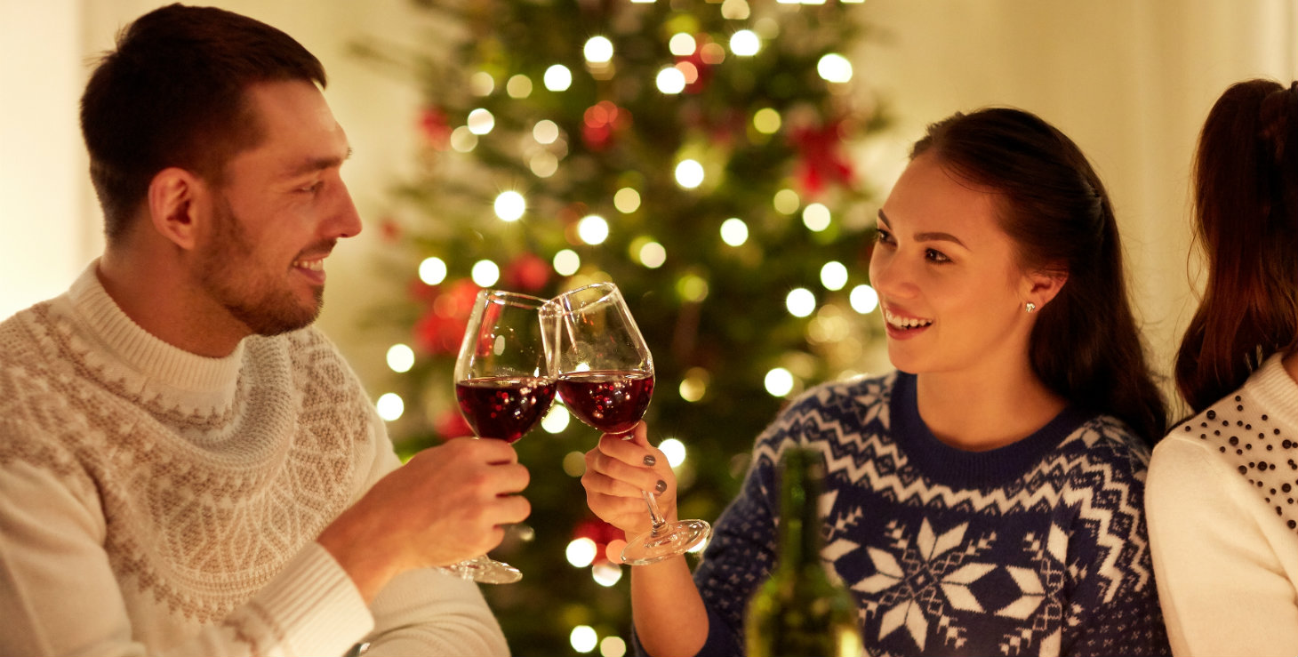 Two people toasting with wine during the holidays