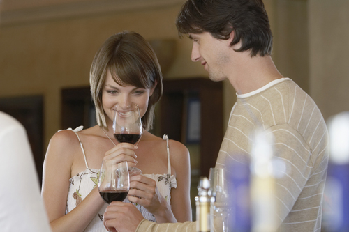 Couple tasting wines