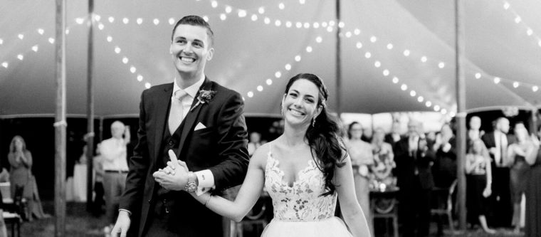Black and White photo of bride and groom at a tent reception