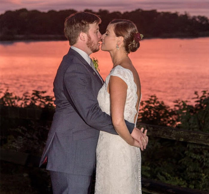 edding Kiss at Sunset in front of the water at our Cheaspeake Bay wedding venue