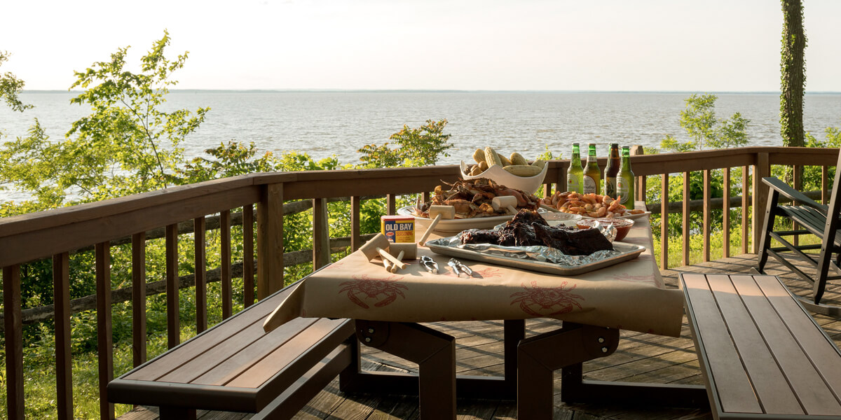 Picnic table with bay view with crab feast and beer