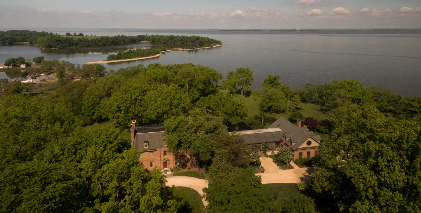 Drone view of Great Oak Manor property with Chesapeake Bay in shot