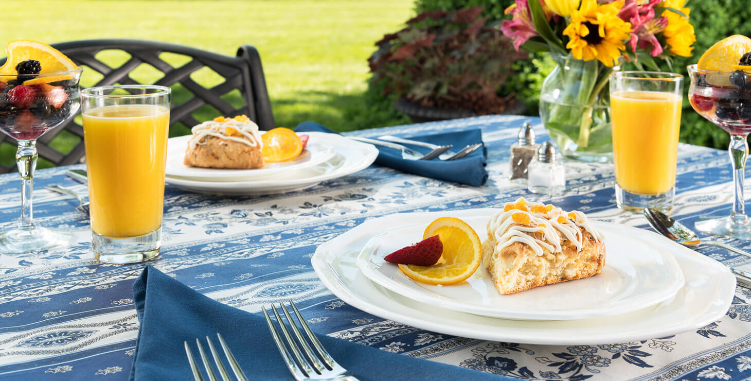 two plates of breakfast on an outdoor table at Greak Oak Manor