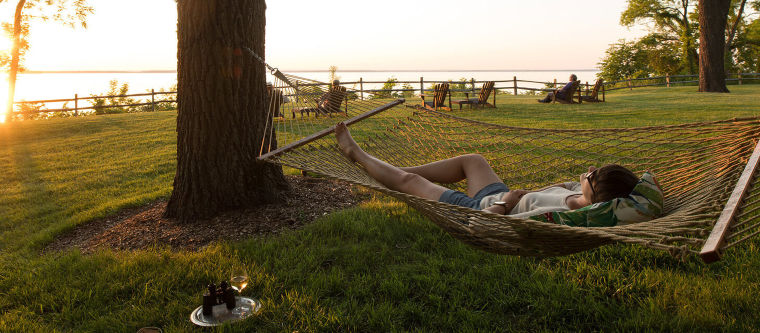 A woman relaxing in a hammock at Maryland hotel