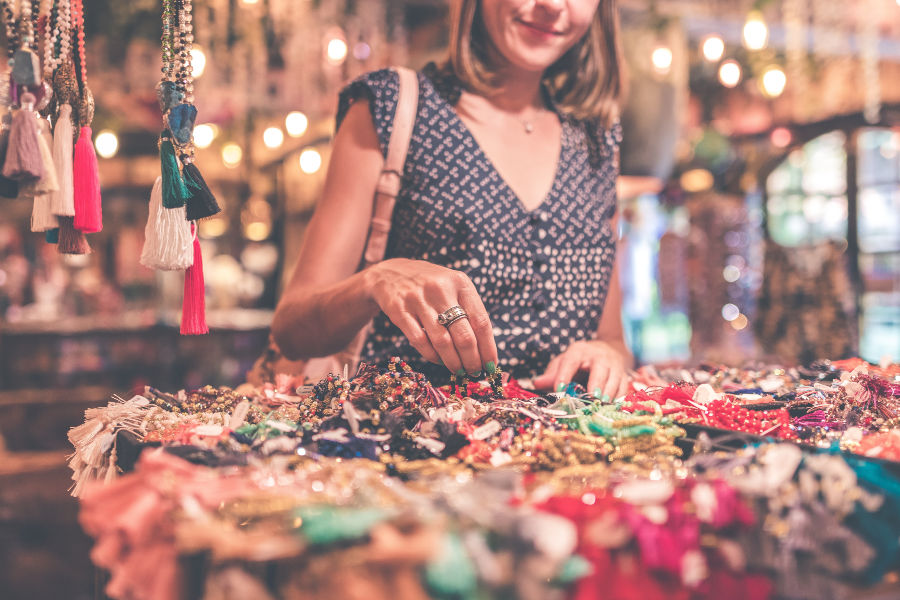 Woman sorting through unique jewelry