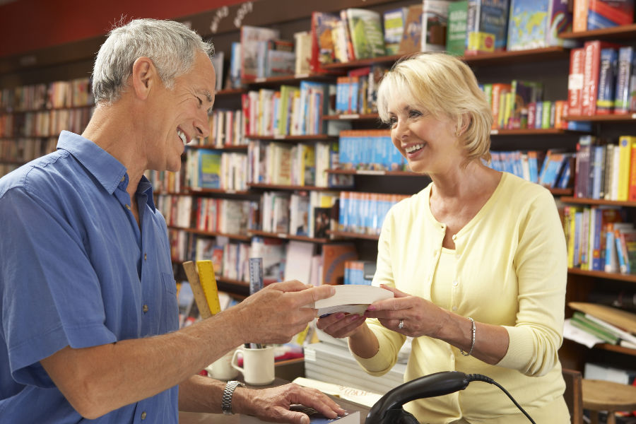 senior couple looking at books in a bookstore