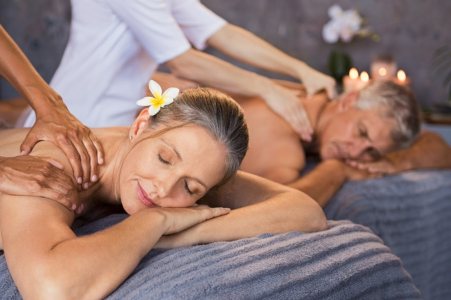 Senior couple getting a couples massage at Great Oak Manor