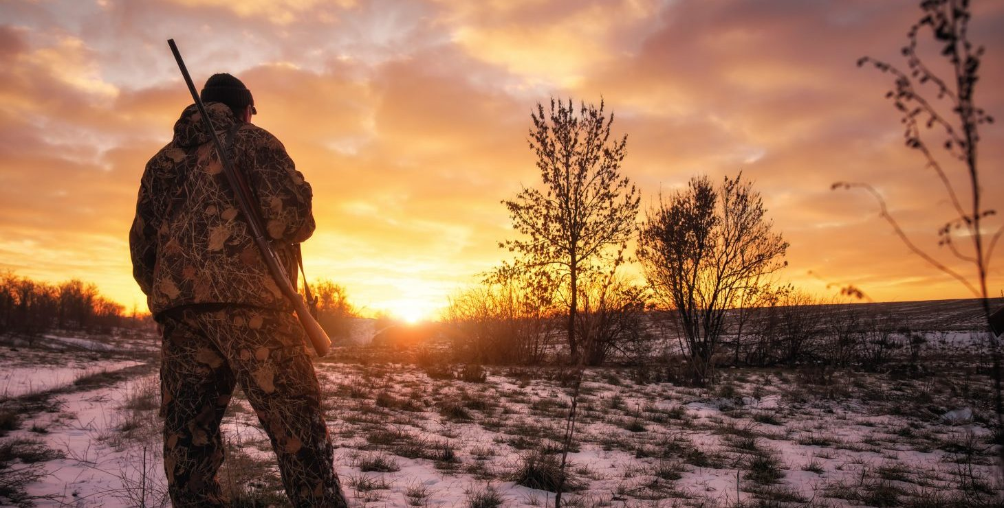a hunter looking at sunset