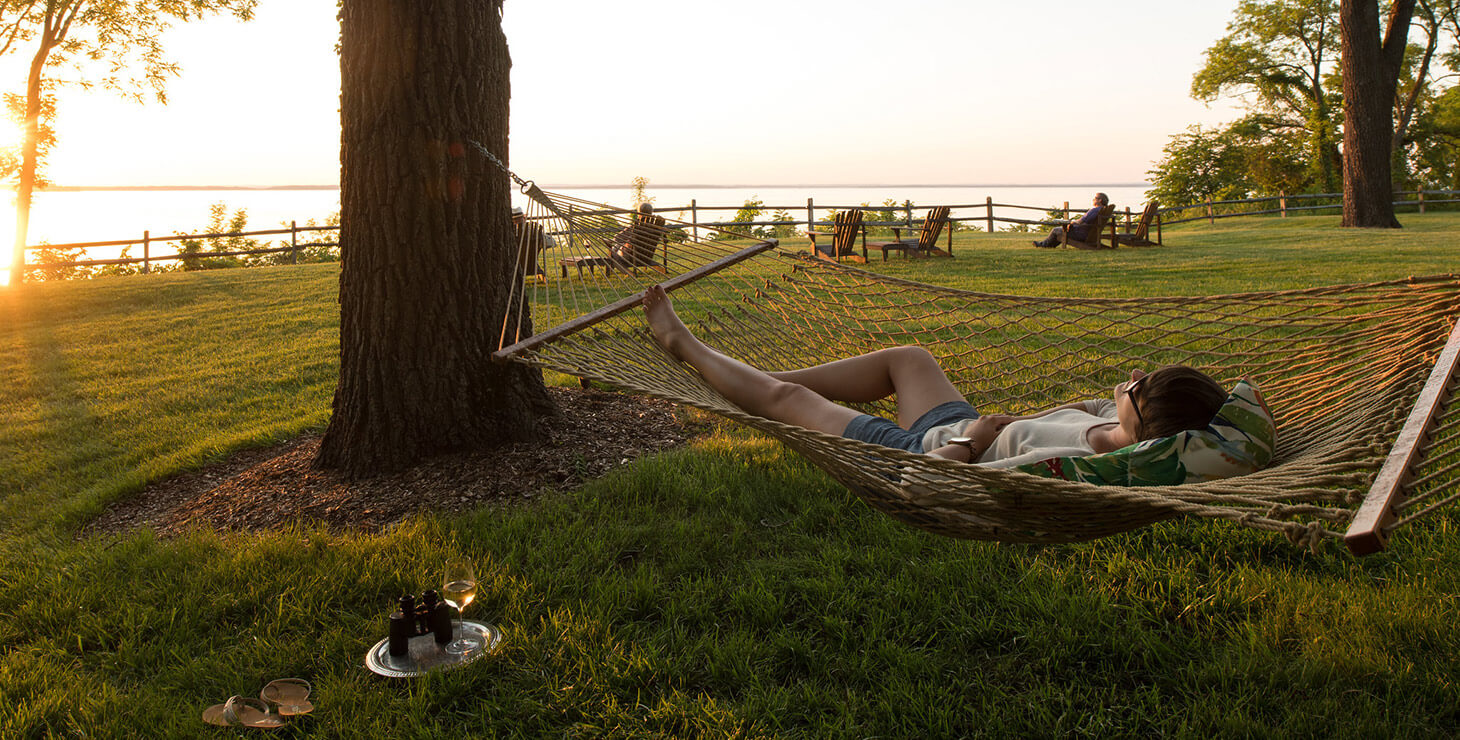 woman relaxing in hammock at our Maryland retreat center
