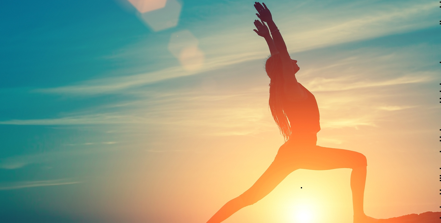 woman doing yoga at sunrise