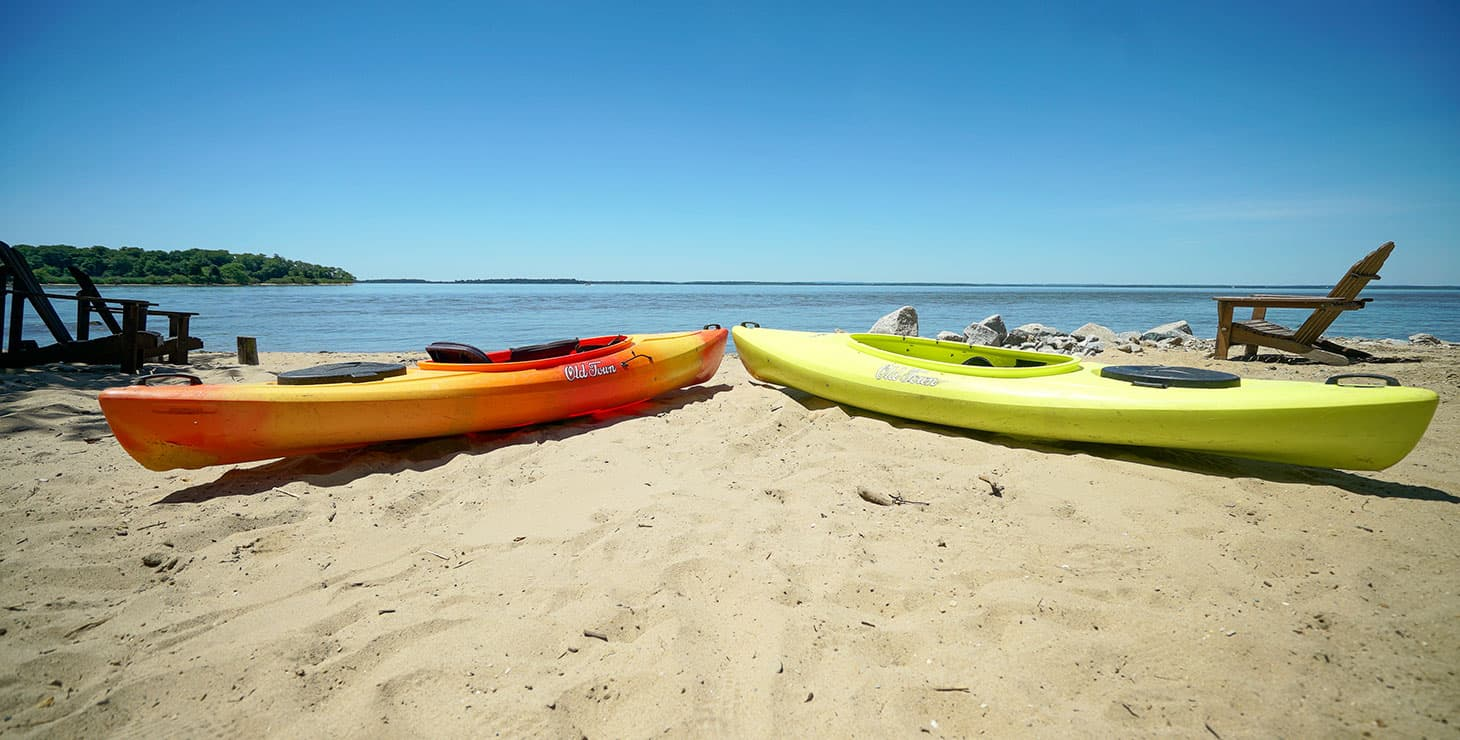 Kayaks on the beach of Chesapeake Bay
