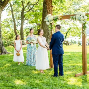 Wedding ceremony at outdoor forest arch