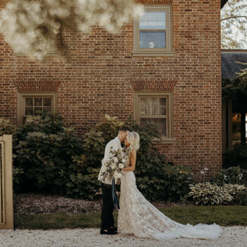couple kissing in front of Great Oak Manor