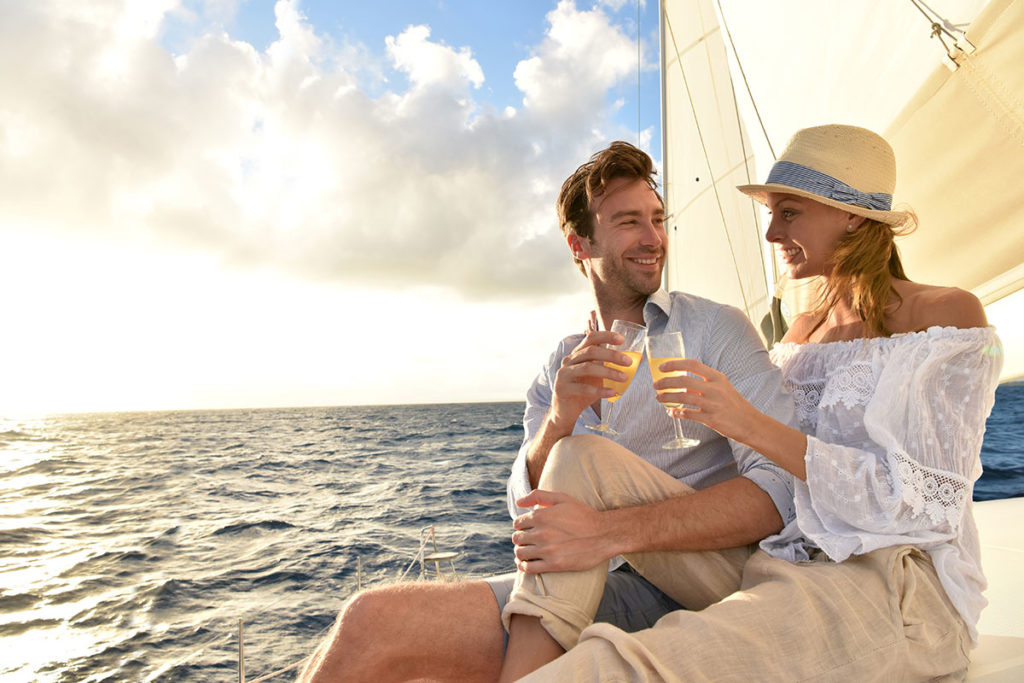 Attractive Couple Sailing and Drinking Champagne