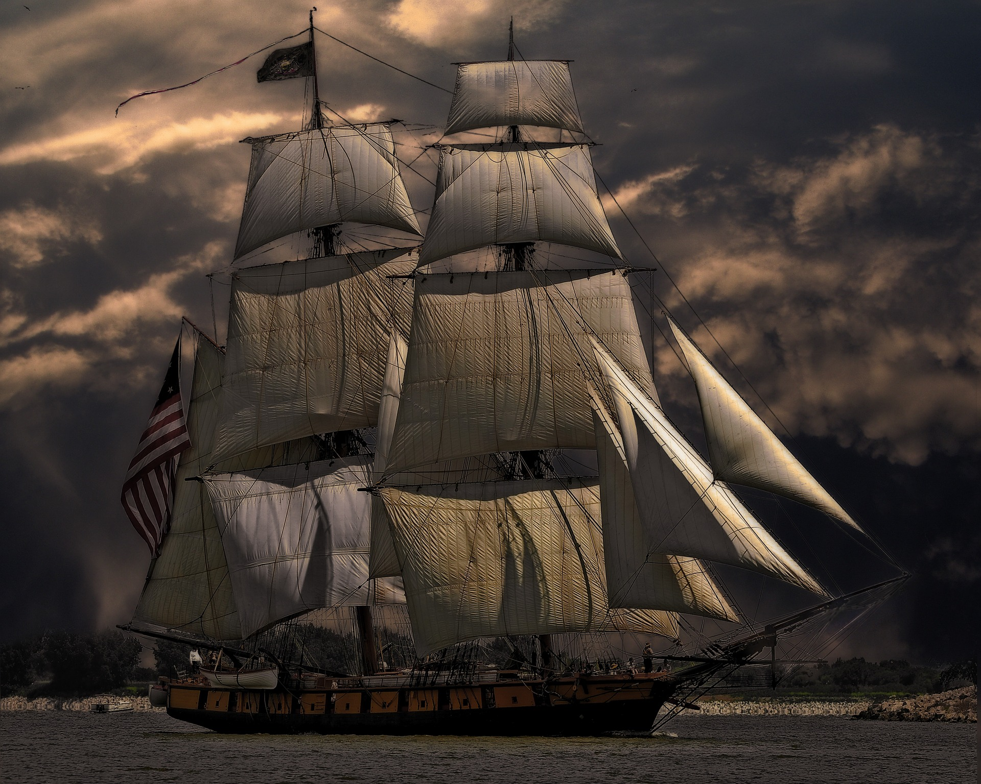 Tall Ship with Sails During Stormy Weather